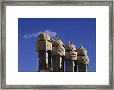 The Strangely Shaped Rooftop Chimneys Framed Print by Taylor S. Kennedy