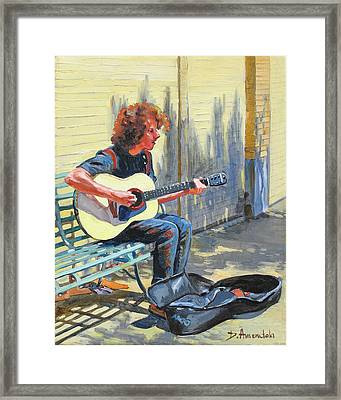The Street Guitarist Framed Print by Dominique Amendola