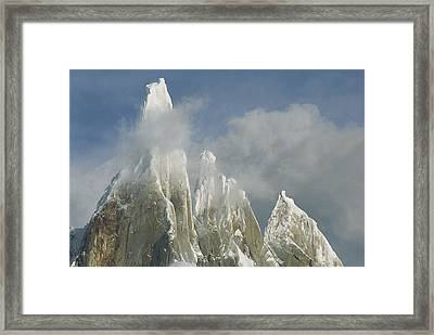 The Summit Of Cerro Torre Massif Rises Framed Print by Jimmy Chin