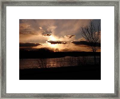 The Sun Is Hiding Framed Print by Christine Peterson