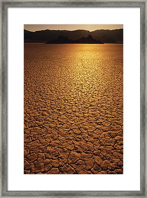 The Sun Reflects Off This Parched Lake Framed Print by Bill Hatcher