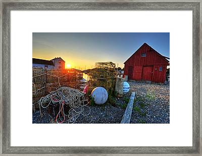 The Sun Rising By Motif 1 In Rockport Ma Bearskin Neck Lobster Traps Framed Print by Toby McGuire