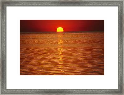 The Sun Sinks Into Pamlico Sound Seen Framed Print by Stephen St. John
