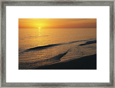 The Sun Sinks Into The Gulf Of Mexico Framed Print by Klaus Nigge