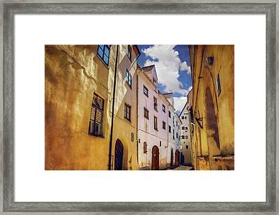 The Sunny Streets Of Old Riga  Framed Print by Carol Japp