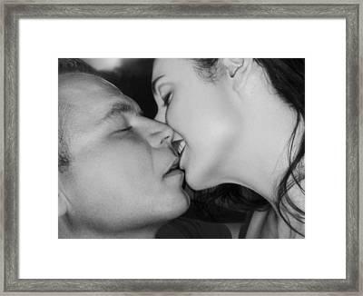 The Surreal Kiss Framed Print by Jaeda DeWalt