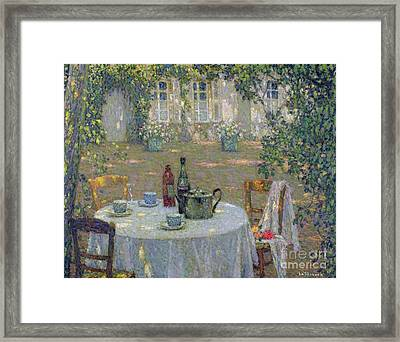 The Table In The Sun In The Garden Framed Print by Henri Le Sidaner