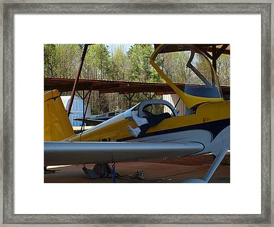 The Tired Pilot Framed Print by Robert Margetts