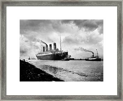 The Titanic Being Towed Framed Print by Jon Neidert