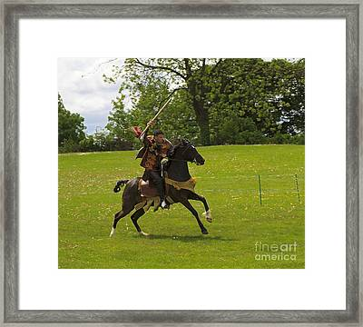 The Toss A Squire Throws A Javelin From Horseback Framed Print by Louise Heusinkveld