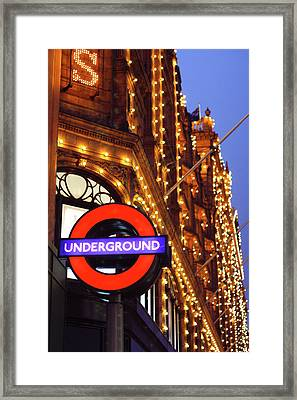 The Underground And Harrods At Night Framed Print