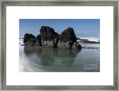 The Unique Rock On The Beach Framed Print by Masako Metz