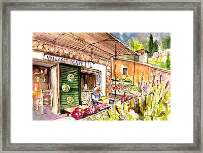 The Village Cafe In Deia Framed Print by Miki De Goodaboom