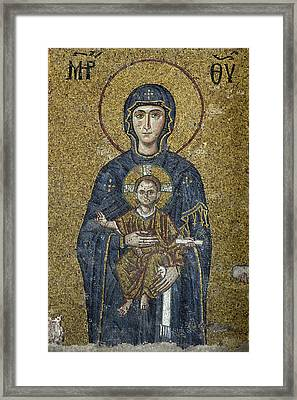 The Virgin Mary Holds The Child Christ On Her Lap Framed Print