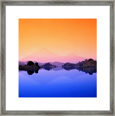 The Virunga Mountains Rise Above Lake Framed Print by David Pluth