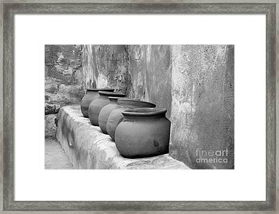 The Wall Of Pots Framed Print by Sandra Bronstein