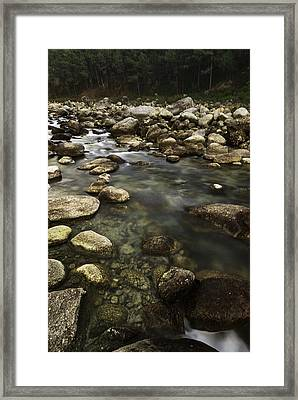 The Waters Flow Framed Print