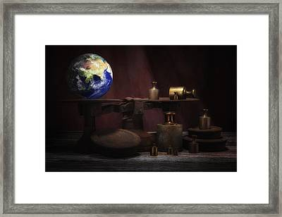 The Weight Of The World Framed Print by Tom Mc Nemar