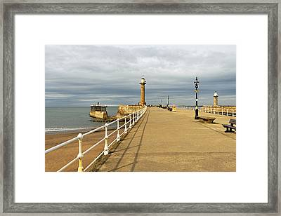 The West Pier And Breakwater - Whitby Framed Print by Rod Johnson