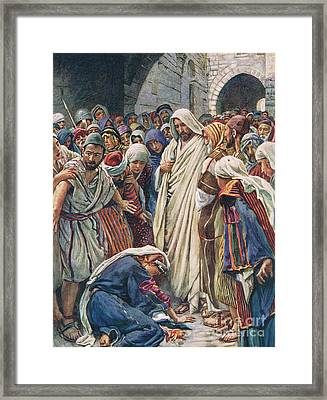 The Woman Who Touched The Hem Of His Garment Framed Print by Harold Copping