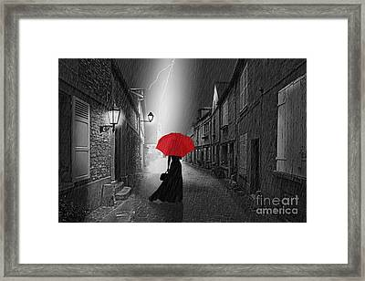 The Woman With The Red Umbrella Framed Print by Monika Juengling