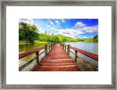 The Wood Dock Framed Print by Debra and Dave Vanderlaan