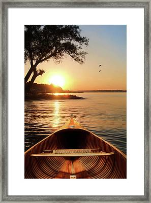 The Wooden Canoe Framed Print by Lori Deiter