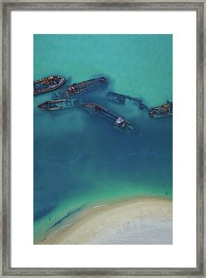 The Wrecks Framed Print
