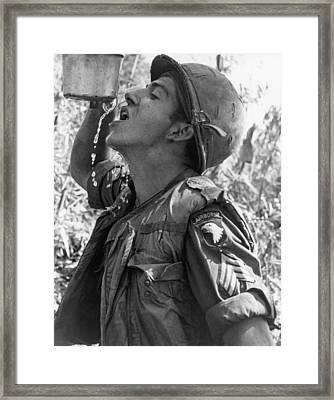 Thirsty Vietnam Soldier Framed Print by Underwood Archives