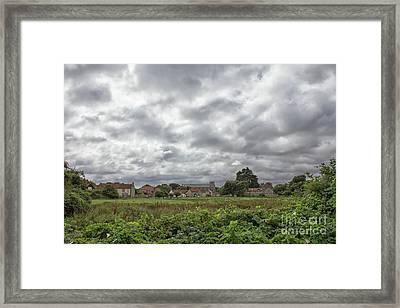 Thornham Village Under A Leaden Sky Framed Print by John Edwards