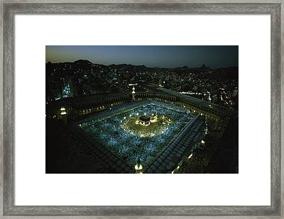 Thousands Of Pilgrims Circle The Kaaba Framed Print by Thomas J. Abercrombie