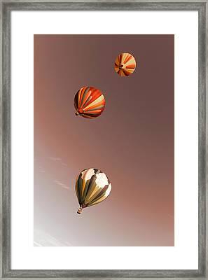 Three Balloons Swirling Skyward Framed Print by Jeff Swan