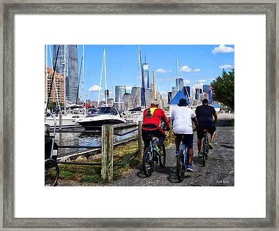 Three Bicyclists By Liberty Landing Marina Framed Print