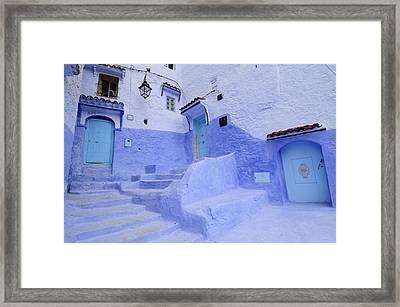 Three Blue Doors In Chefchaouen  Framed Print by Liz Pinchen