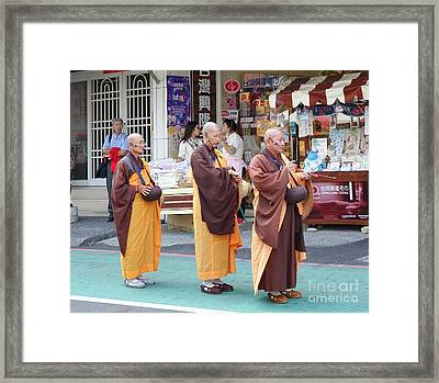 Framed Print featuring the photograph Three Buddhist Monks Chant Scriptures by Yali Shi