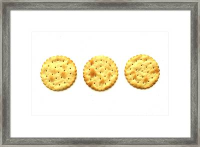 Three Crackers Framed Print