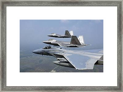 Three Fa-22 Raptors Fly In Formation Framed Print by Stocktrek Images
