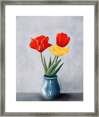 Three Flowers In A Vase Framed Print
