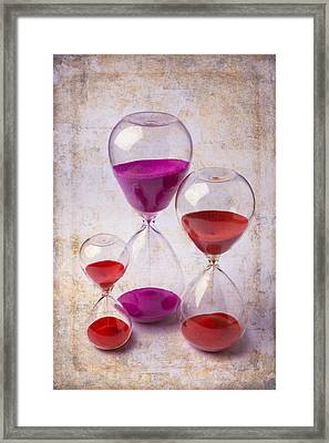 Three Hourglasses Framed Print