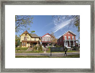 Three Houses And A Bench Framed Print