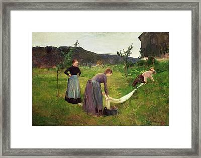 Three Ladies Washing Framed Print by Harriet Backer