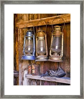 Three Lanterns And A Shoe Framed Print