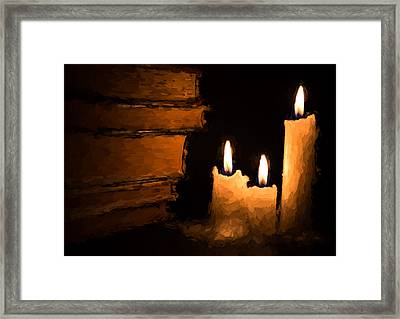 Three Lit White Candles And Old Books Framed Print by John Williams