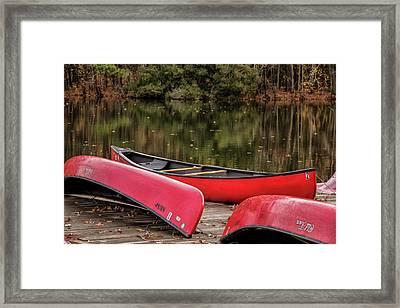 Three Red Canoes Framed Print by Robert Anastasi