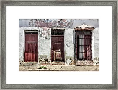 Three Red Doorways Framed Print