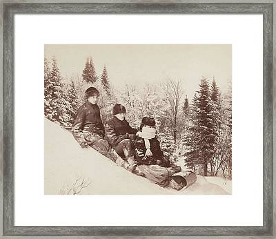 Three Tobogganers On A Snowy Hill Framed Print