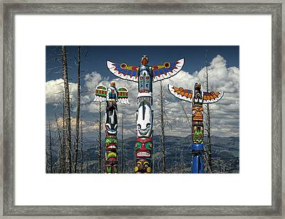 Three Totem Poles In The Northwest Framed Print