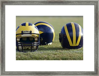 Three Wolverine Helmets Framed Print