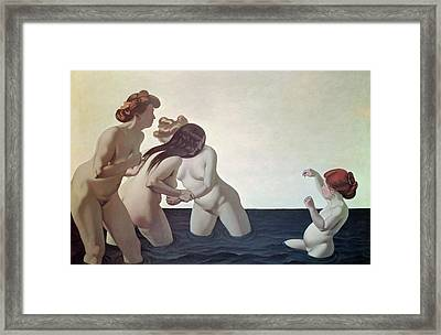 Three Women And A Young Girl Playing In The Water Framed Print