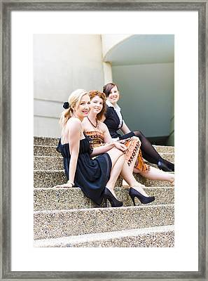 Three Young Attractive Woman Sitting On Steps Framed Print